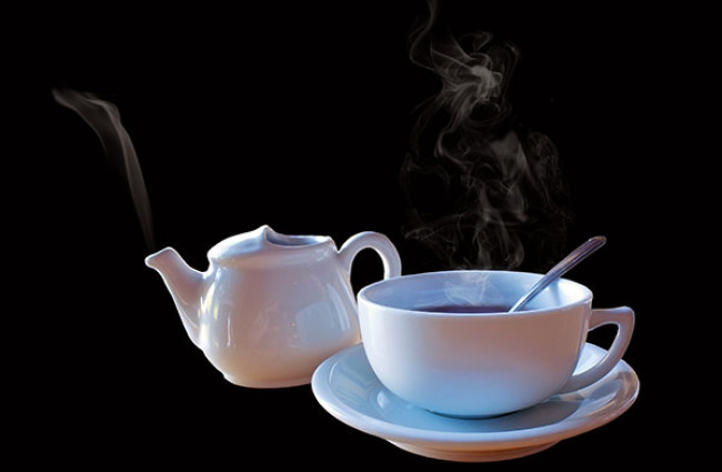 Tea with Pot on black background