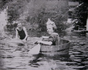 Pioneer girl paddling in barrel bathtub