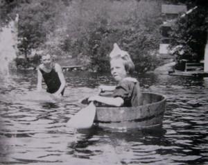 Pioneer girl paddling in barrel bathtub
